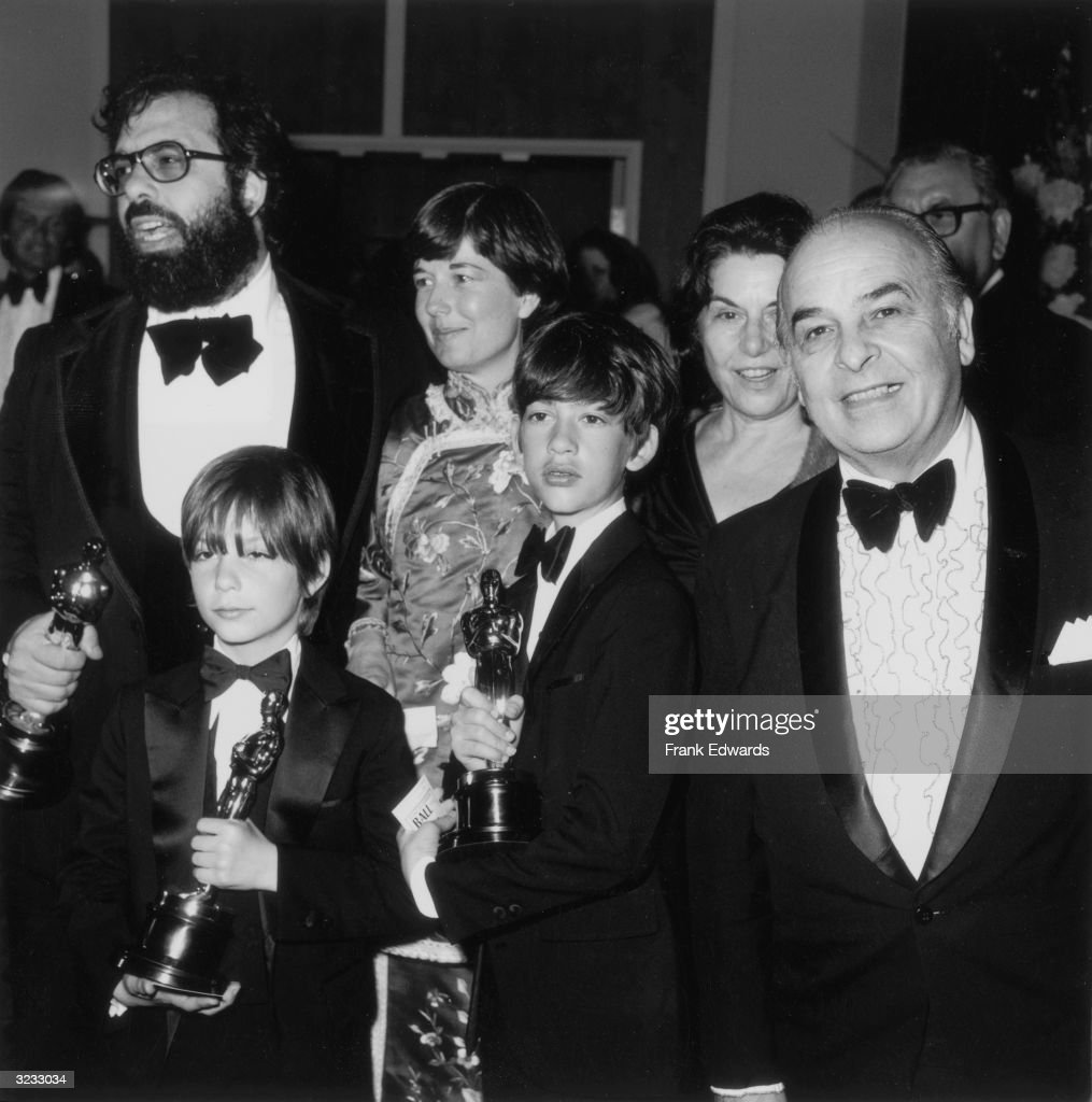American film director Francis Ford Coppola stands with his family, holding three Oscars for his film, 'The Godfather, Part II,' during the 47th Annual Academy Awards at the Dorothy Chandler Pavilion of the Los Angeles Music Center, Los Angeles, California. Clockwise, from left, his wife, Eleanor, his parents, Pennito and Carmine, and sons, Roman and Gian Carlo.