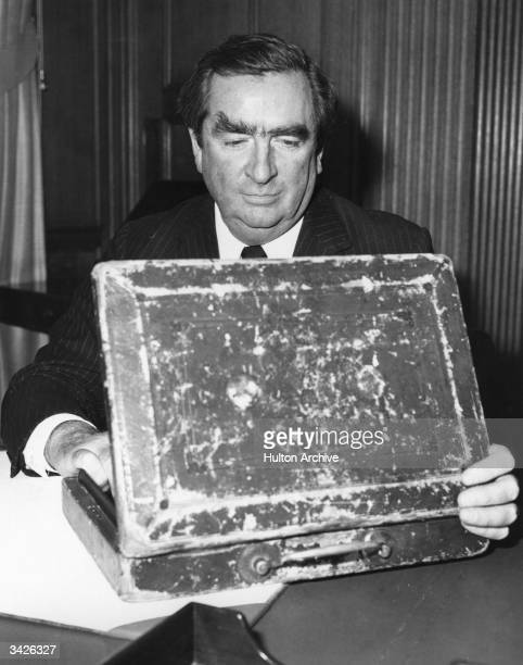 British Labour politician and Chancellor of The Exchequer Denis Healey opening the budget box or The Gladstone Box as it is known in which the papers...