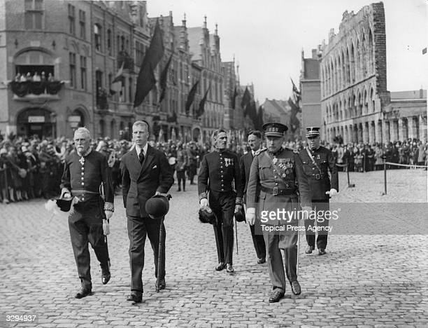 Charles Prince Regent of Belgium walking through Ypres Square for the great ceremony of remembrance at the Menin Gate The Duke of Windsor as Prince...