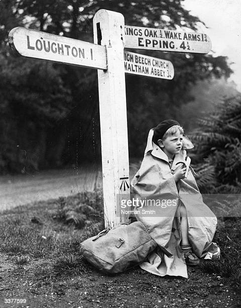 A youthful walker in Epping Forest wrapped up to keep warm he stops to boost his energy with a banana