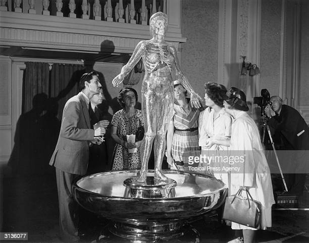 Members of the press inspect 'Lumena' a transparent robot made by German scientists on display at the British Food Fair in Olympia London 6 and a...