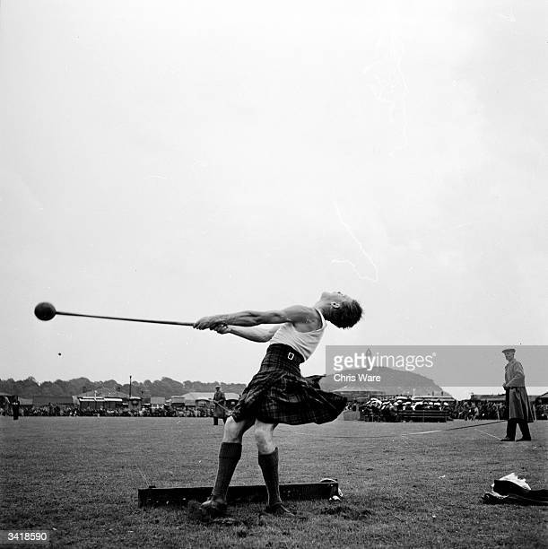 Louis Stewart, a contestant in the hammer throwing competition at the Strathallan Highland Games in Stirlingshire. Highland games are held all over...