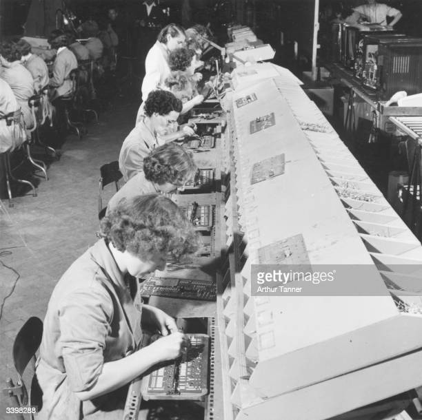 Production line workers assembling printed circuit panels at Pye TV Manufacturing at Lowestoft Norfolk