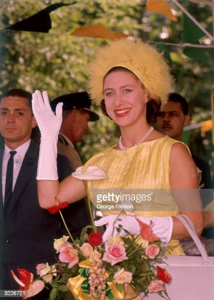 Princess Margaret waving to crowds at Denbeigh in Jamaica. She is visiting the island to attend the ceremonies marking the former British colony's...