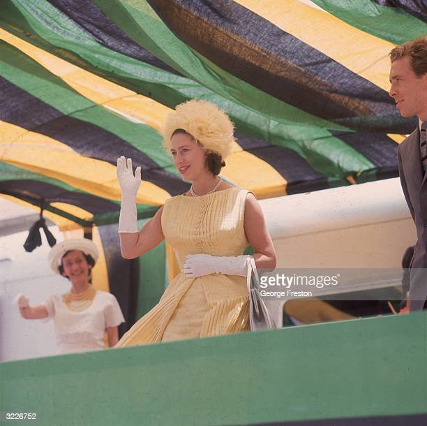 Princess Margaret waving to crowds during a dance display at Williamsfield in Jamaica . The royal couple are visiting the island to attend the...