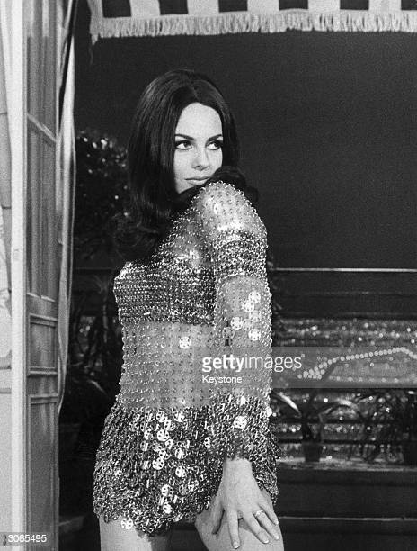 French actress Michele Mercier in a chainmail minidress