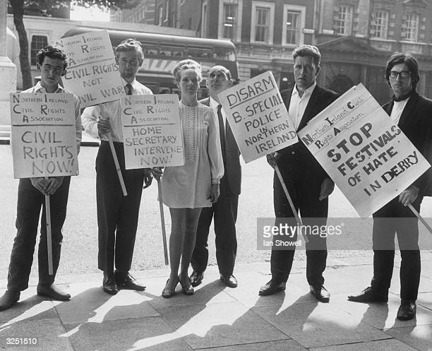 Members of the Northern Ireland Civil Rights Association protesting outside the Home Office in London while the prime minister of Northern Ireland...