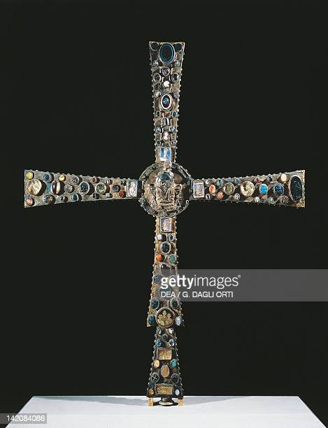 8th century processional cross known as Desiderio's Cross in wood embellished with metal plates gemstones and vitreous paste insets5 x 99 cm...