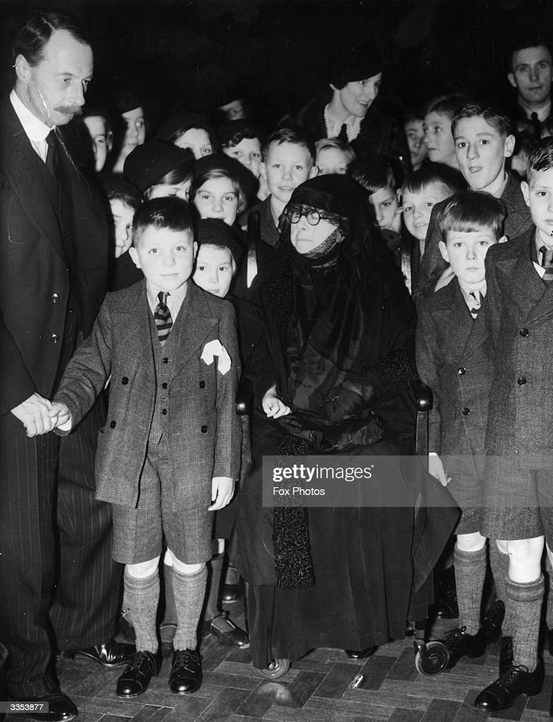 A group of Barnardo Boys at Australia House, London. They are leaving for Australia where they will be living on farms. Shaking the hand of one of the boys is the Duke of Devonshire while Mrs Barnardo is sitting in the centre of the group.