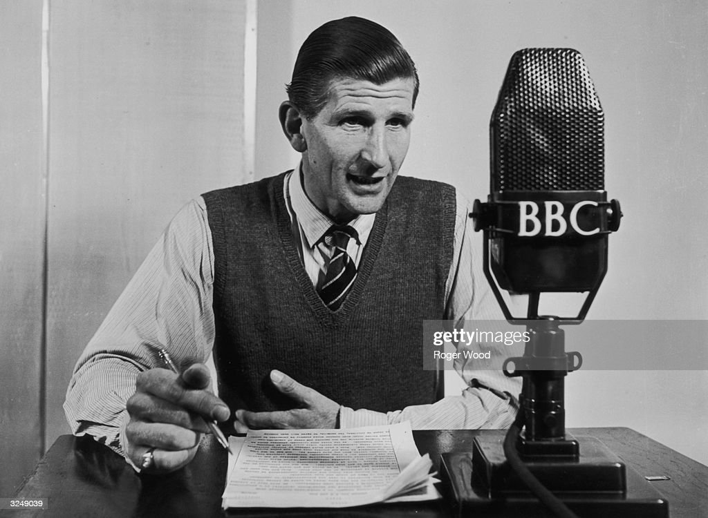 BBC announcer Alvar Lidell pictured during a broadcast. Original Publication: Picture Post - 5611 - Now We Are Seven - pub. 1951