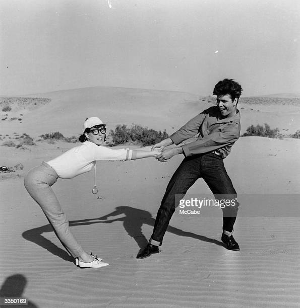Singer Cliff Richard and actress Una Stubbs larking about during filming the EMI musical 'Wonderful Life' alternatively titled 'Swinger's Paradise'
