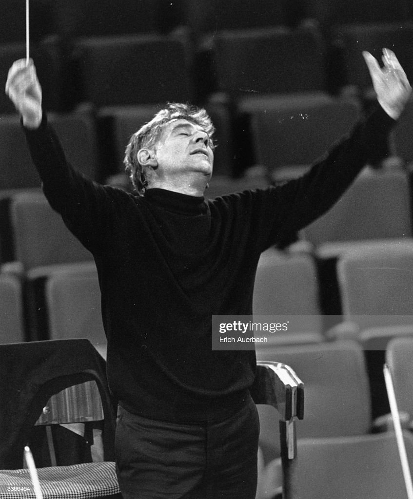US composer, conductor and pianist Leonard Bernstein (1918 - 1990) conducting.