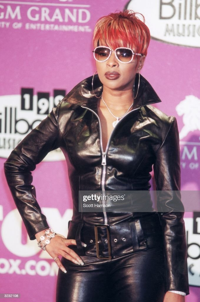 American R&B singer Mary J. Blige, in a black leather outfit, poses for photographers at the 1999 Billboard Music Awards, held at the MGM Grand Hotel and Casino, Las Vegas, Nevada, December 8, 1999. Blige was a presenter in the ceremony.