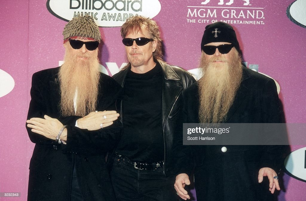 American rock group ZZ Top poses for photographers at the 1999 Billboard Music Awards, held at the MGM Grand Hotel and Casino, Las Vegas, Nevada. The group served as presenters in the awards ceremony. Pictured are guitarist Billy Gibbons, drummer Frank Beard (C) and bassist Dusty Hill.