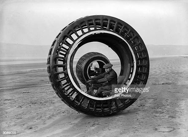 Electronically driven wheels which revolve while the drivers remain stationary, the invention of J A Purves and his son of Taunton, are tested at...
