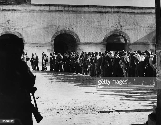 Some of the hundreds of prisoners at the Chateau Montjuich in Barcelona shortly after the capture of the city by General Franco