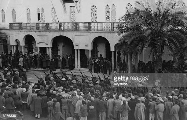 Townspeople of Benghazi Italy's second largest naval base in Africa watch in the Civic Square as the town is formally handed over to the British...