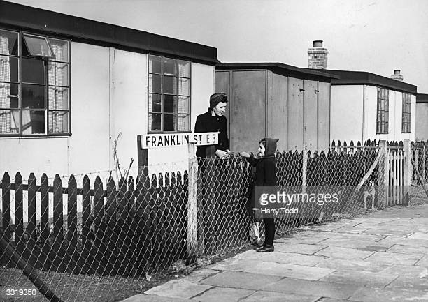 In BromleybyBow a heavily blitzed area of East London a mother sees her daughter off to school from their prefab home The street is named Franklin...