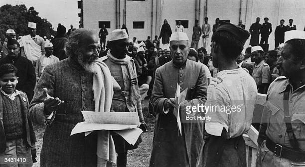 Indian statesman Pandit Jawaharlal Nehru attends a meeting of the Constituent Assembly in the Council House Library New Delhi to decide on the...