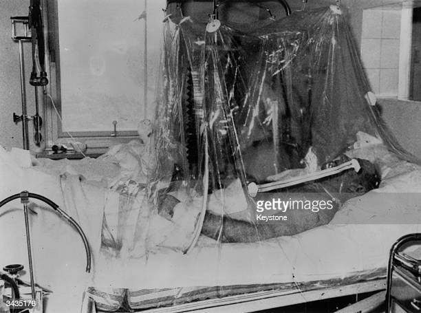 Manchester United football manager Sir Matt Busby lying in an oxygen tent in Munich Hospital after the air crash which killed eight members of his...