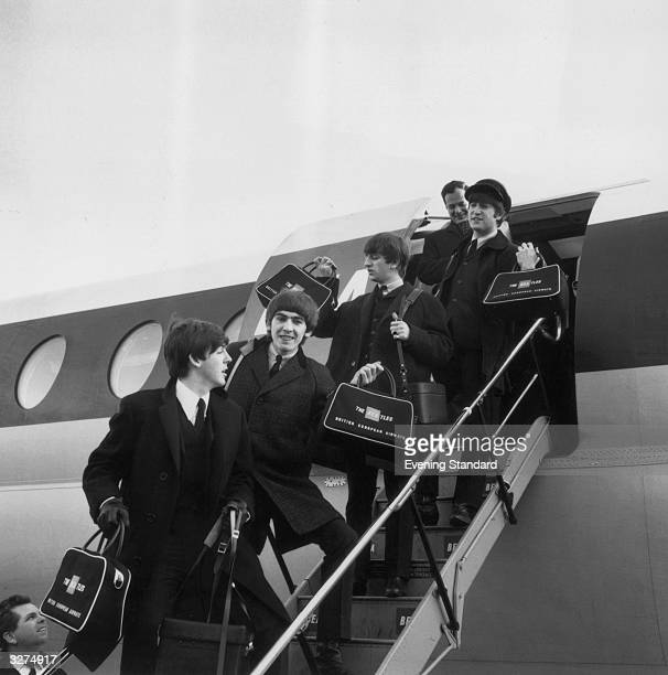 The Beatles from left to right Paul McCartney George Harrison Ringo Starr and John Lennon arrive at London Airport with manager Brian Epstein