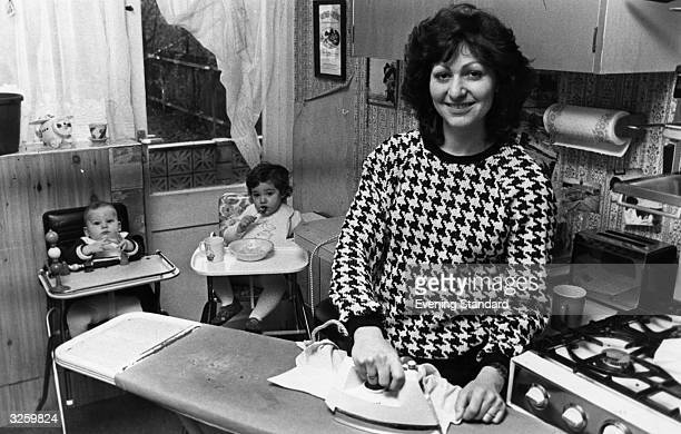 Rebecca Cohen at home with her young children Francesca and Jodi