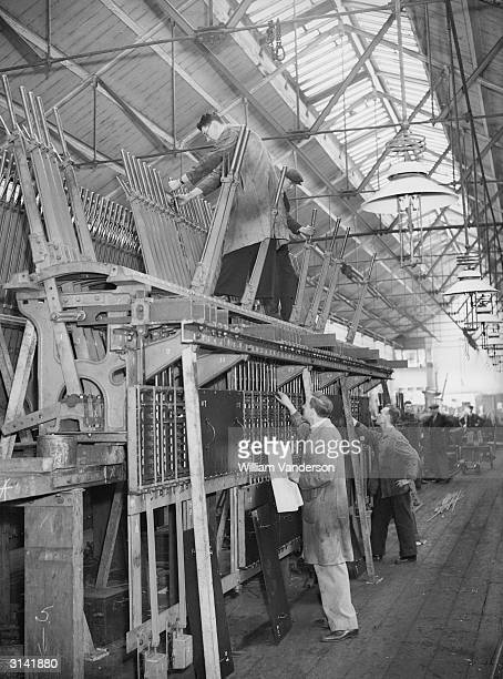 Men at work erecting locking frames for signal boxes at the GWR signal works in Reading Berkshire