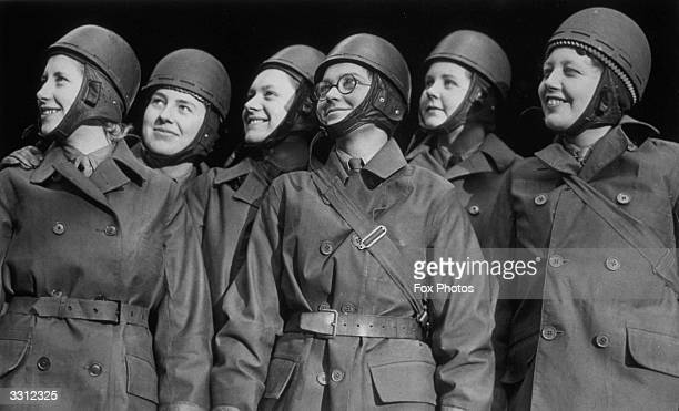 At a training centre in the South Eastern Command a line of ATS women, wearing their crash helmets, are trained in navigation and motor bike riding.