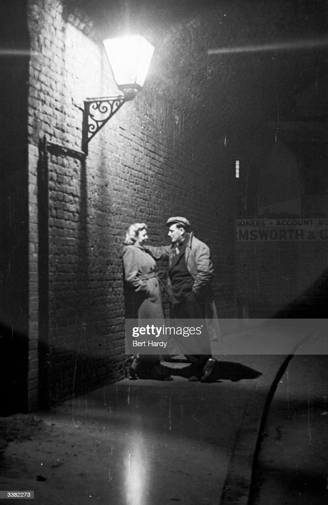 A courting couple part company after a night out in the Elephant and Castle, South London. Original Publication: Picture Post - 4694 - Life At The Elephant - pub. 1949