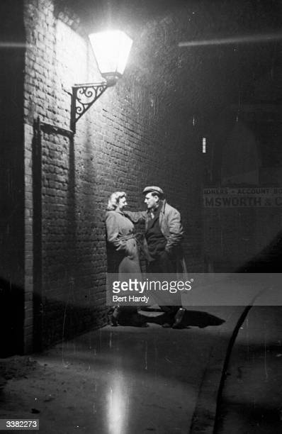 Courting couple part company after a night out in the Elephant and Castle, South London. Original Publication: Picture Post - 4694 - Life At The...