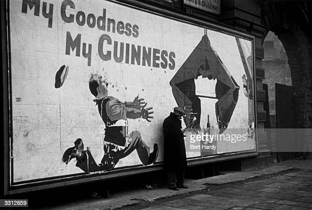 A Guinness advertisement in the Elephant and Castle south London The slogan reads 'My Goodness My Guinness' Original Publication Picture Post 4694...