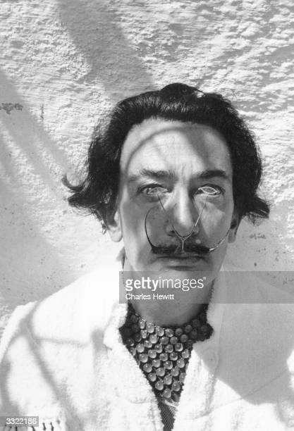 Spanish surrealist artist Salvador Dali wearing a customized pincenez Original Publication Picture Post 7465 A Day With Salvador Dali pub 1955