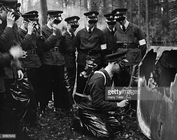 A group of junior firemen watch fellow trainee Brian Howe as he cuts through an old metal tank with portable apparatus as part of their two year...