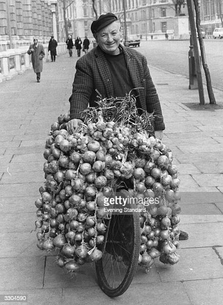 Mr Jean Caroff, from Brittany, selling onions in Parliament Street, London.