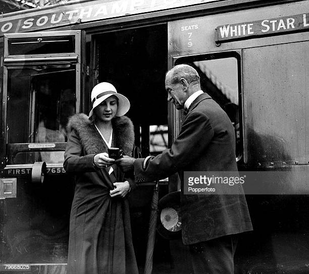 8th July 1930 Mrs Helen WillsMoody is presented with her Wimbledon singles and doubles medals at Waterloo Station London by RJ McNair prior to her...
