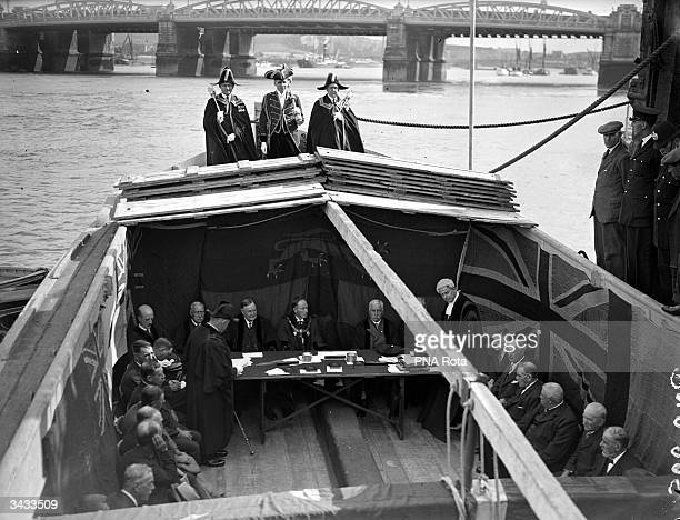 A court of law set up in the hull of a barge at Rochester Pier on the River Medway in Kent a ceremony which has remained unchanged for 200 years