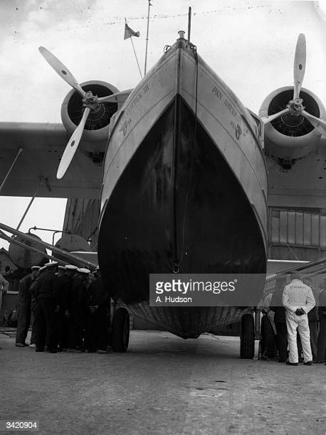 Giant hull of PanAmerican flying boat 'Clipper III' at the Imperial Airways base at Hythe in Southampton Water With Imperial Airways 'Caledonia' it...