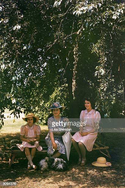 Queen Elizabeth Queen Consort to KIng George VI with Princesses Elizabeth and Margaret Rose in the grounds of Windsor Castle Berkshire