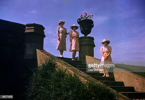 Queen Elizabeth seen with her daughters Princess Elizabeth and Princess Margaret at Windsor Castle.