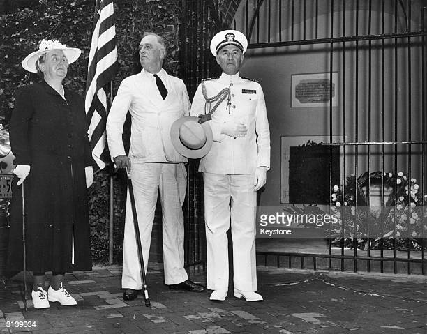 Queen Wilhelmina of the Netherlands with President Franklin Delano Roosevelt 32nd President of the USA and on the right his naval aide Captain John...