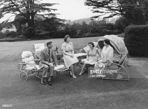 The Royal family sit relaxing in the grounds of the Royal Lodge Windsor King George VI Princess Elizabeth Princess Margaret Rose and Queen Elizabeth