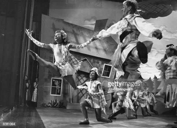 American dancer VeraEllen born VeraEllen Westmeyr Rohe leaping across the set of the N P Rathvon musical 'Happy Go Lovely' at Elstree Studios hand in...