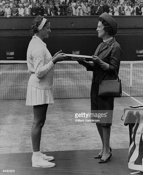 Princess Marina the Duchess of Kent presenting the trophy to Margaret Smith after she beat Billie Jean Moffitt of the USA 6 3 6 4 on the centre court...