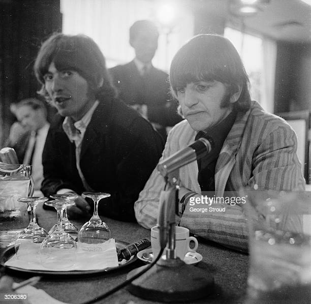 Beatles George Harrison and Ringo Starr during a press conference at London Airport held on the group's return from Manila