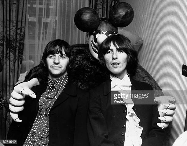 Beatles Ringo Starr and George Harrison are embraced by a 'Blue Meanie' a character from their animated musical film 'Yellow Submarine'