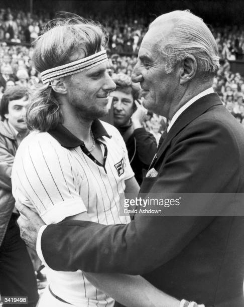 Swedish tennis player Bjorn Borg being congratulated by former Wimbledon champion Fred Perry after winning the Men's Singles Title at Wimbledon for...