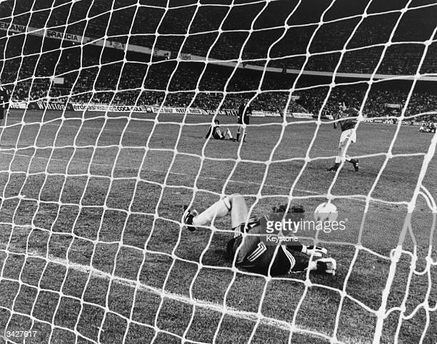 German goalkeeper Schumacher saves Bossis' shot at the goal in the penalty shootout after the World Cup semifinal match between West Germany and...