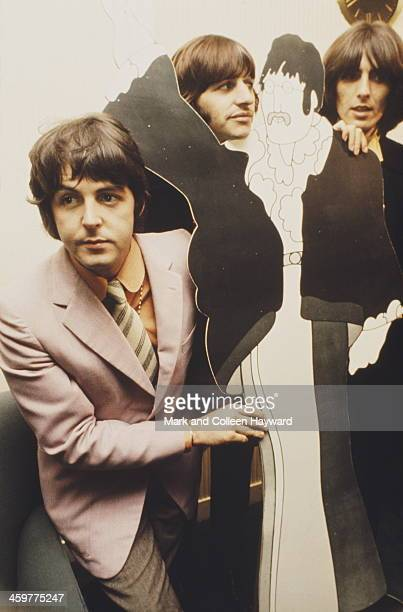 Paul McCartney Ringo Starr and George Harrison from The Beatles attend a press screening for the film 'Yellow Submarine' along with a cut out of an...