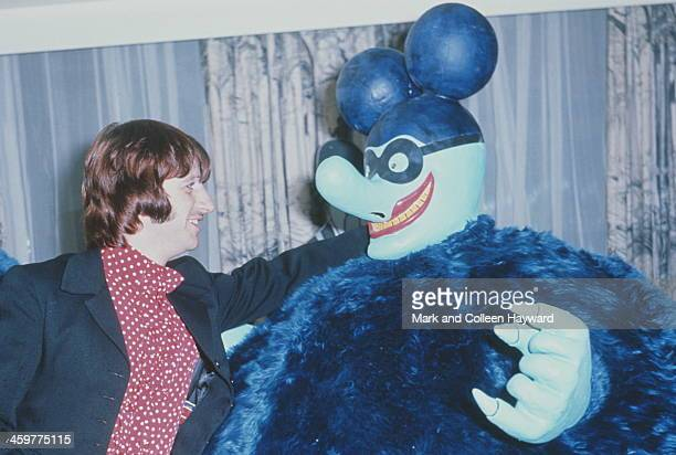 Ringo Starr from The Beatles attends a press screening for the film 'Yellow Submarine' along with a Blue Meanie at the Bowater House Cinema in...