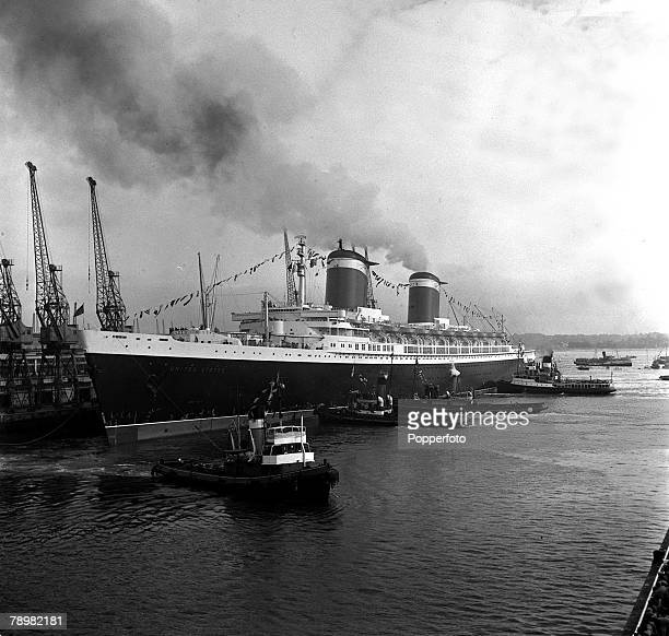 8th July Tugs pull in the ocean liner 'United States' into her berth at the ocean terminal Southampton